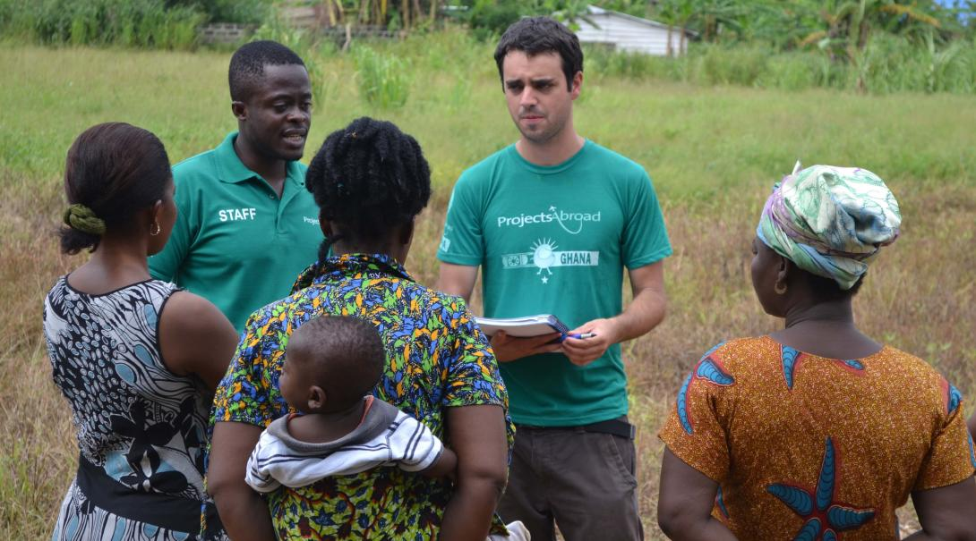 Projects Abroad volunteer doing a social work project in Ghana helps his supervisor doing field work.
